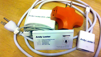 Power cord, display dongle, cube tap and business cards